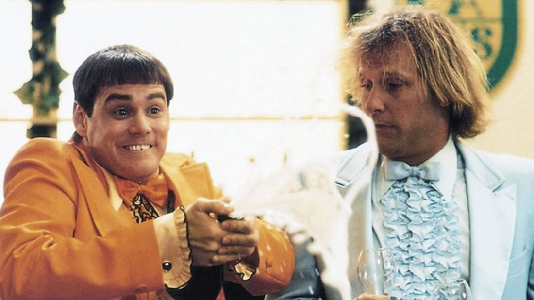 Jim Carrey, one hideous bowl cut, and Jeff Daniels star in Dumb and Dumber (1994).