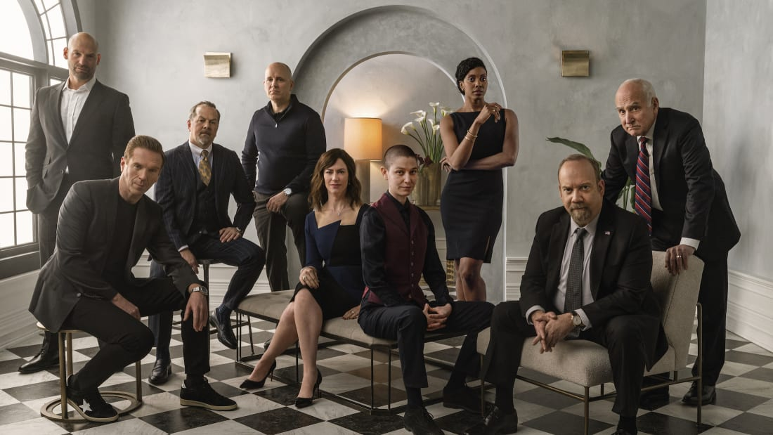 (L-R): Corey Stoll, Damian Lewis, David Costabile, Kelly AuCoin, Maggie Siff, Asia Kate Dillon, Condola Rashad, Paul Giamatti, and Jeffrey DeMunn are at each other's throats in Billions.