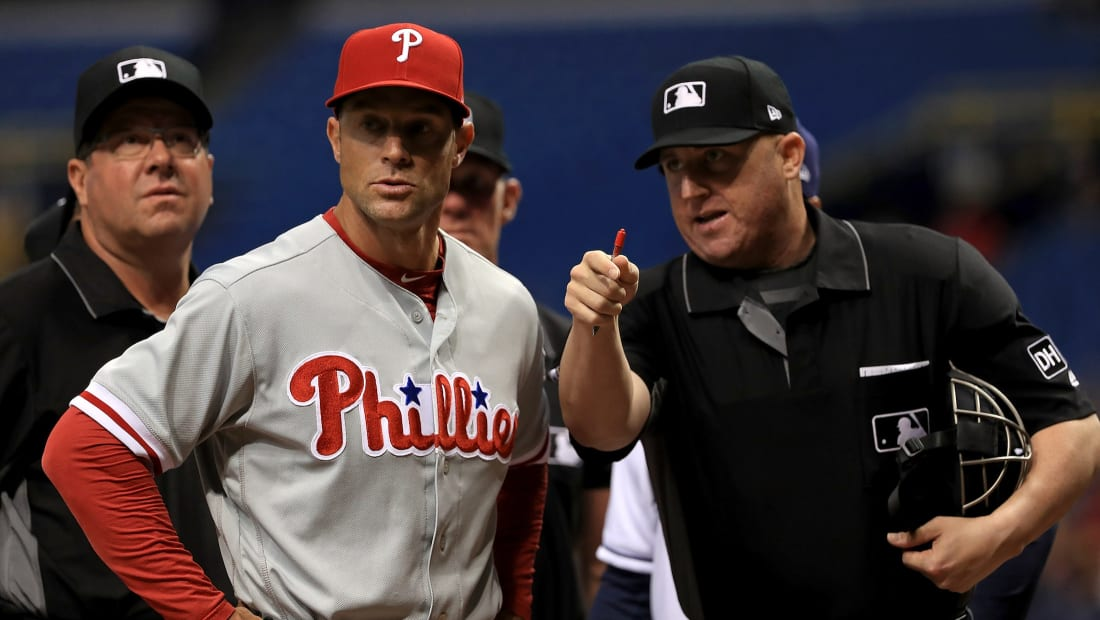 Gabe Kapler, manager of the Philadelphia Phillies, talks with home plate umpire Ryan Blakney during a game against the Tampa Bay Rays.
