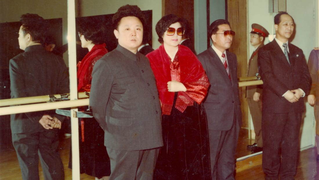 Kim Jong-Il, Choi Eun-hie, and Shin Sang-ok in a scene from Ross Adam and Robert Cannan's The Lovers & the Despot (2016).