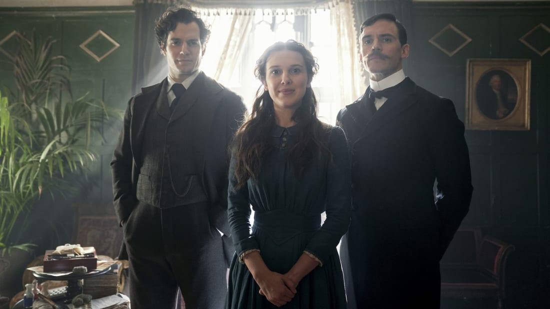 Henry Cavill as Sherlock Holmes, Millie Bobby Brown as Enola Holmes, and Sam Claflin as Mycroft Holmes in Netflix's Enola Holmes (2020).