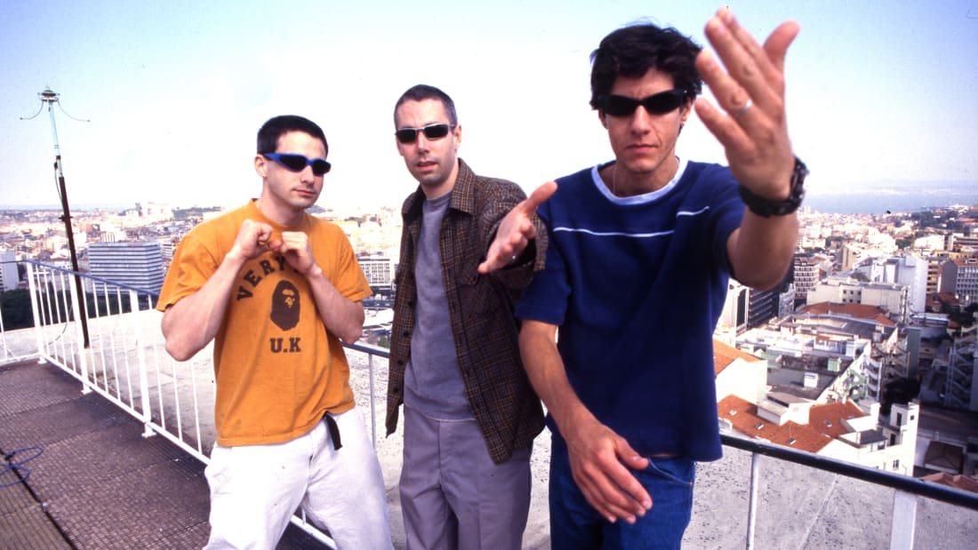 L to R: Beastie Boys Ad-Rock (Adam Horowitz), MCA (Adam Yauch), and Mike D (Michael Diamond) pose in Portugal 1998.