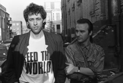 """Bob Geldof (L) and Midge Ure (R) outside a London recording studio while working on """"Do They Know It's Christmas?"""" on November 25, 1984."""