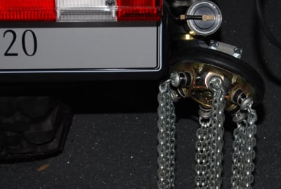 Chains hanging from service vehicles serve a purpose.