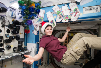 Expedition 42 Flight Engineer Samantha Cristoforetti of the European Space Agency relaxes on board the International Space Station on December 25, 2014.