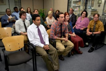 The Dunder Mifflin gang gathers in the conference room on The Office.