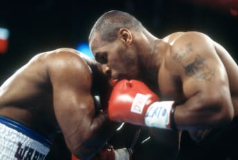 Evander Holyfield (L) and Mike Tyson (R) compete in their rematch in Las Vegas on June 28, 1997. The bout would make sports history.