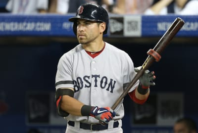 Jacoby Ellsbury of the Boston Red Sox wields a bat with a ring in 2013.