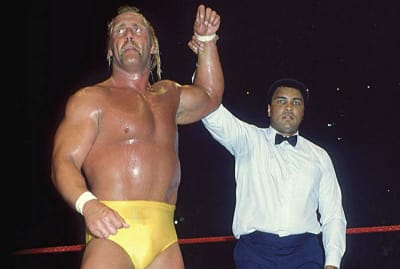 Hulk Hogan gets his hand raised by Muhammad Ali during the first WrestleMania in 1985.