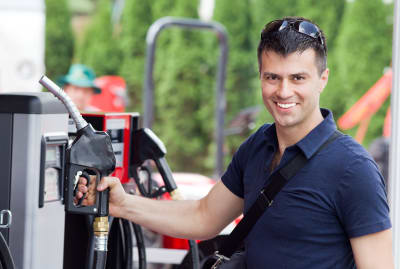 Pumping gas can elevate your mood. Just look at this man.