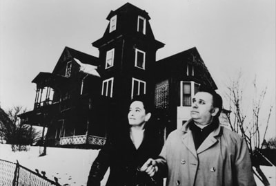 Ed Warren and Lorraine Warren in Amityville II: The Possession (1982).