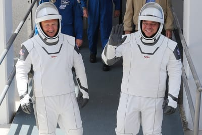 NASA astronauts Doug Hurley and Bob Behnken make their way to the SpaceX Falcon 9 rocket with the Crew Dragon spacecraft on launch pad 39A at the Kennedy Space Center on May 30, 2020 in Cape Canaveral, Florida.