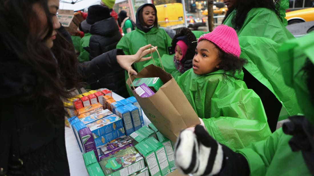Girl Scouts sell cookies in New York City.