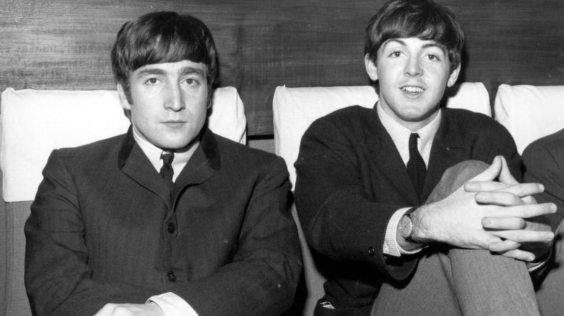 John Lennon (left) and Paul McCartney (right) from The Beatles.
