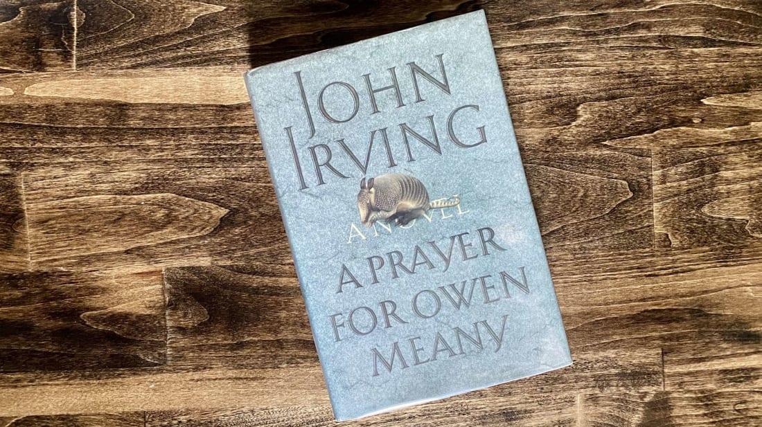"The first sentence of John Irving's seventh novel, A Prayer for Owen Meany, begins, ""I am doomed to remember a boy with a wrecked voice ..."""