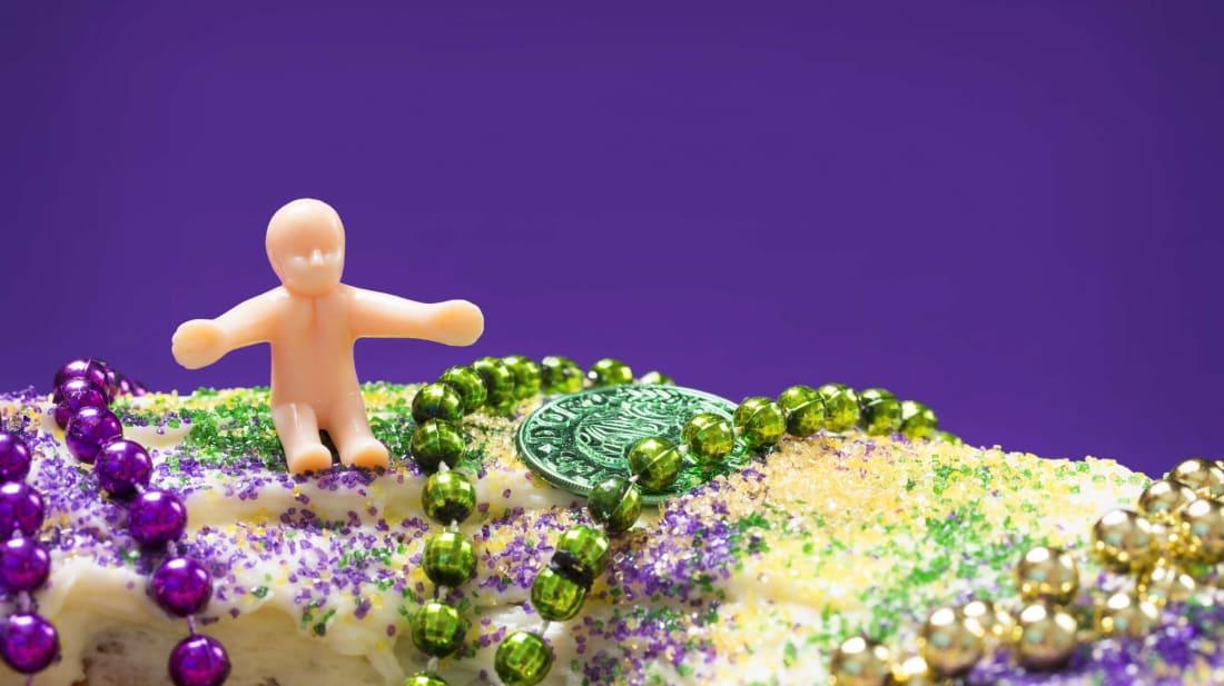 Nothing says Mardi Gras like a plastic baby stuffed inside a cake.