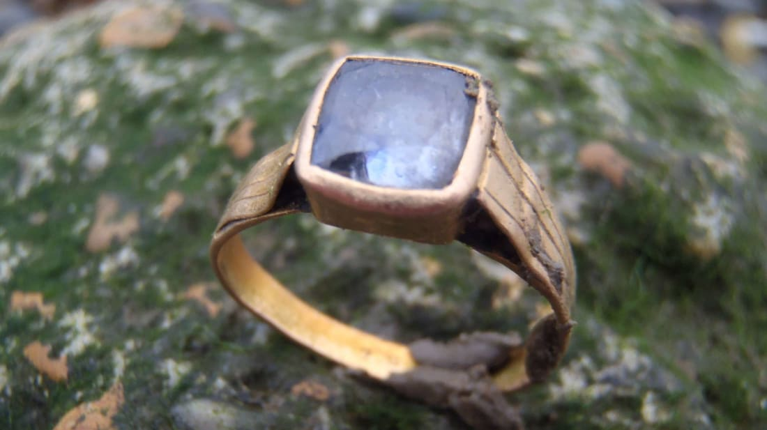 Nicola White discovered this antique gold and sapphire ring while mudlarking on the River Thames.