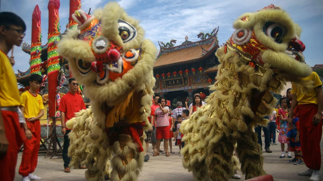 Lion dancers celebrating the Lunar New Year in Malaysia.