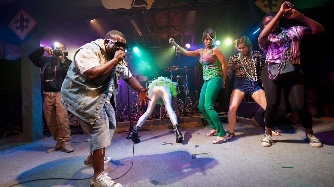 New Orleans bounce artist 5th Ward Weebie raps as women from the audience twerk onstage at Tipitina's in 2014.