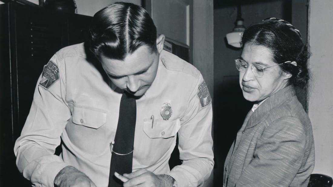 Rosa Parks being fingerprinted on February 22, 1956, by Deputy Sheriff D.H. Lackey as one of the people indicted as leaders of the Montgomery bus boycott.