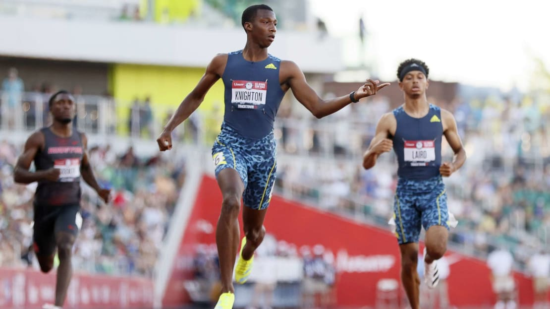 Erriyon Knighton, center, after winning his heat at the Olympic trials on June 26, 2021.