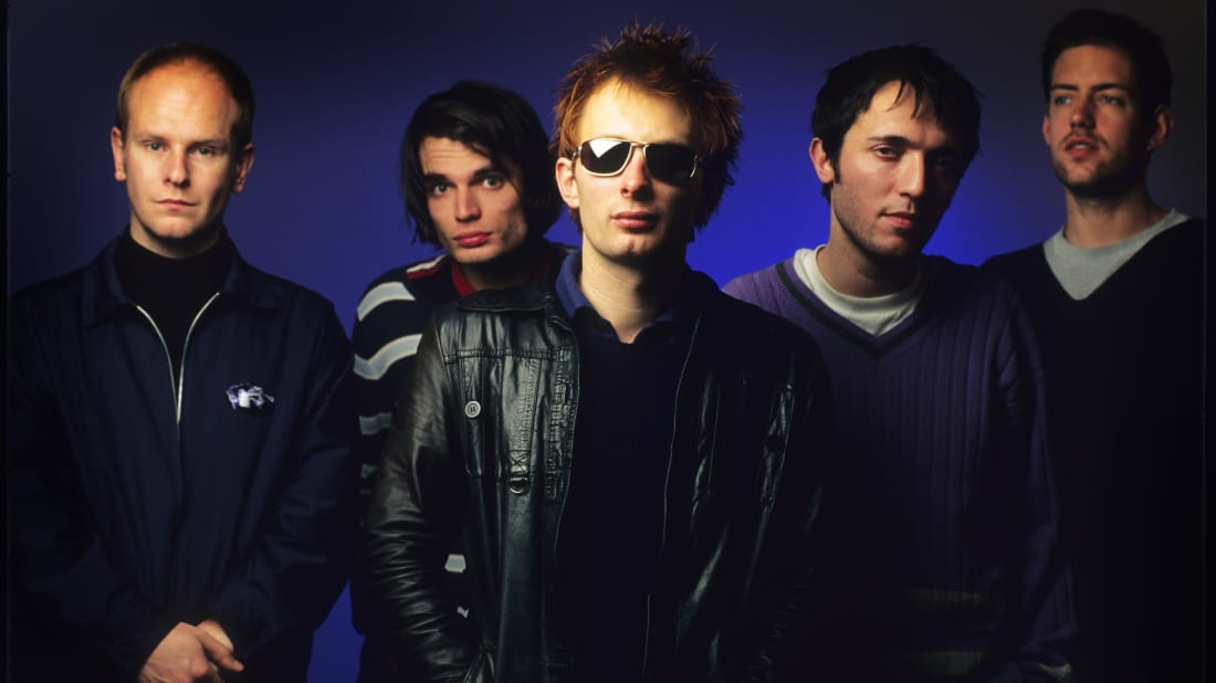 A photo of Radiohead members Phil Selway, Jonny Greenwood, Thom Yorke, Colin Greenwood, and Ed O'Brien in 1995.