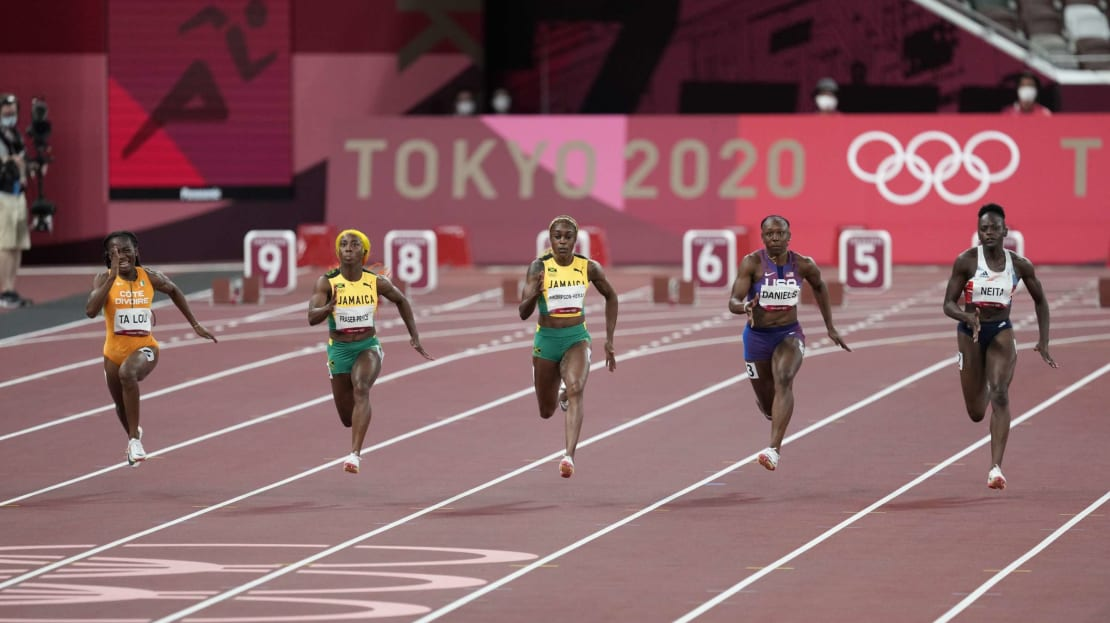 Elaine Thompson-Herah (third from left) on her way to a gold medal in the women's 100-meter dash at Tokyo 2020 Olympics.