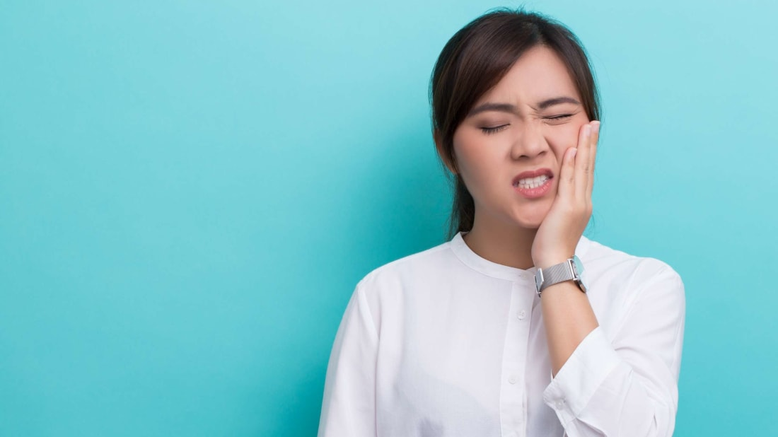 This woman's tooth pain is actually helping her avoid further damage.