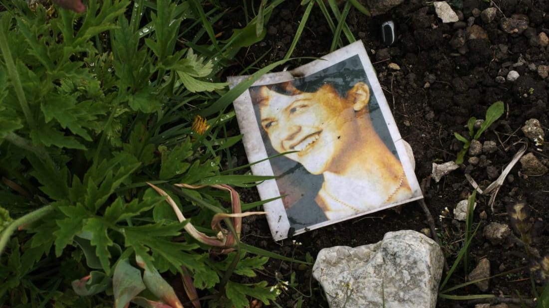 A photograph of Sylvia Plath on her grave.