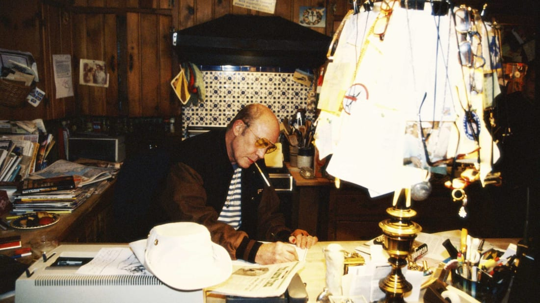 Hunter S. Thompson at his desk in April 1996.
