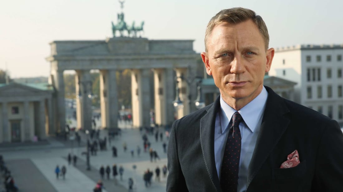 Daniel Craig in front of the Brandenburg Gate, which he could probably buy with his Knives Out franchise paycheck.