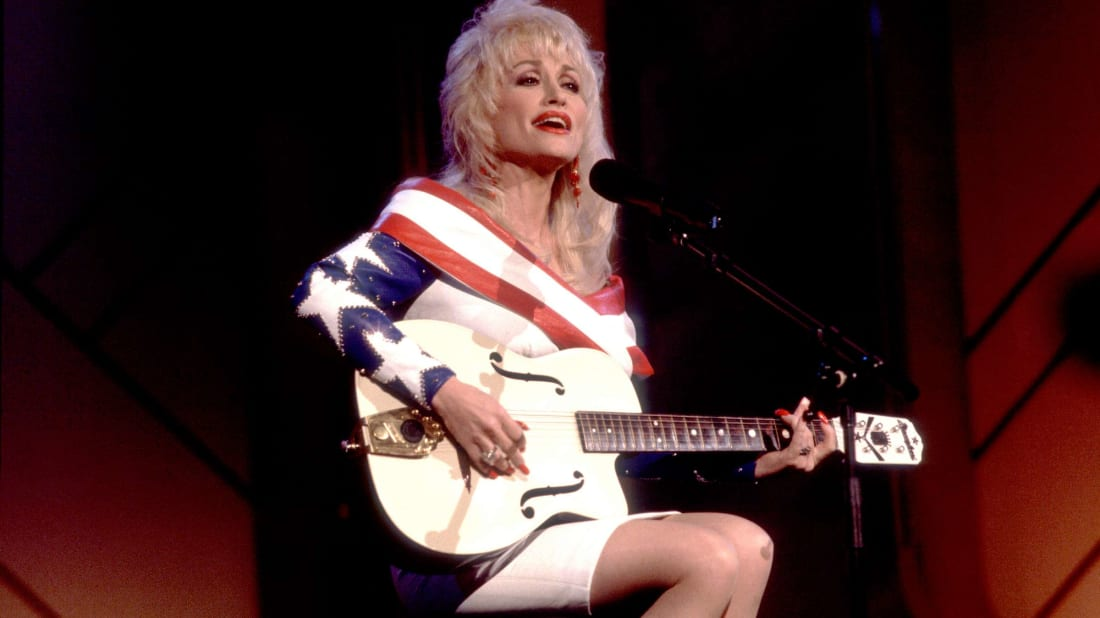 Dolly Parton performs on the Oprah Winfrey Show in 1991.