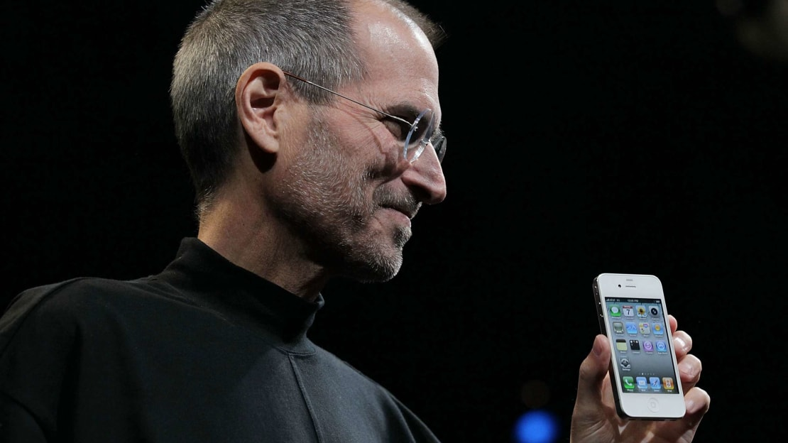 Steve Jobs reveals the iPhone 4 at a conference in 2010.
