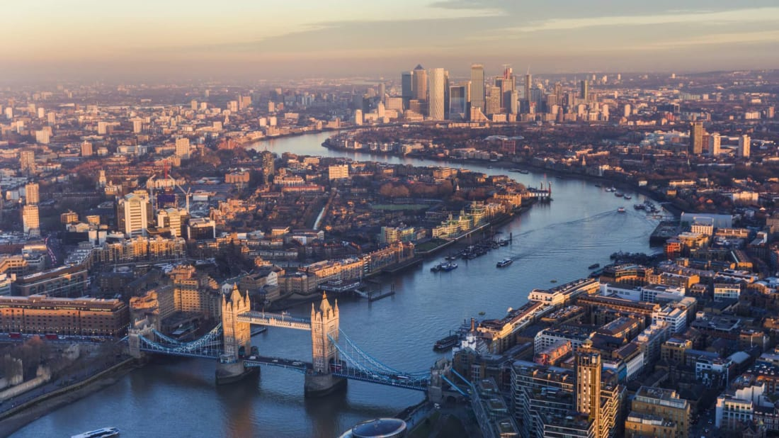 An aerial view of the river Thames at sunset.