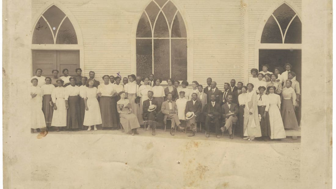 A group of people standing in front of a church—possibly Vernon Chapel AME Church in Tulsa, Oklahoma—in the early 20th century.
