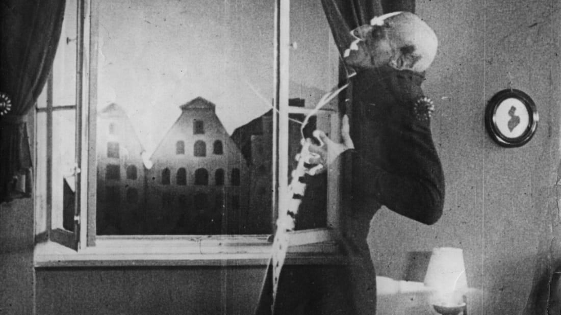 Max Schreck as the vampire Count Orlok being destroyed by sunlight in Nosferatu (1921).