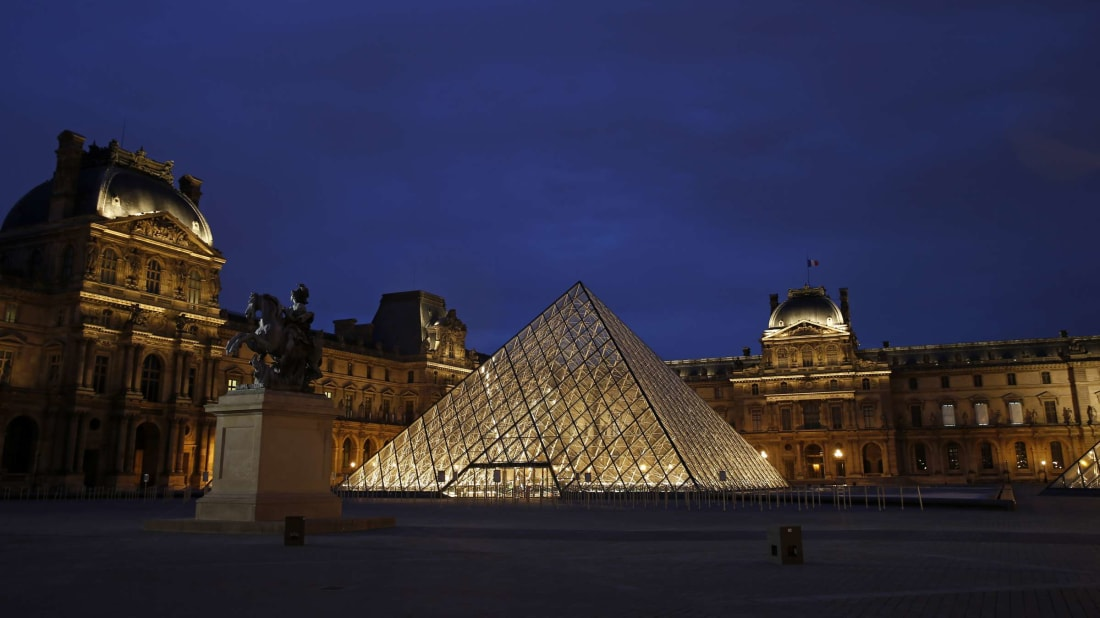 The Louvre by night.