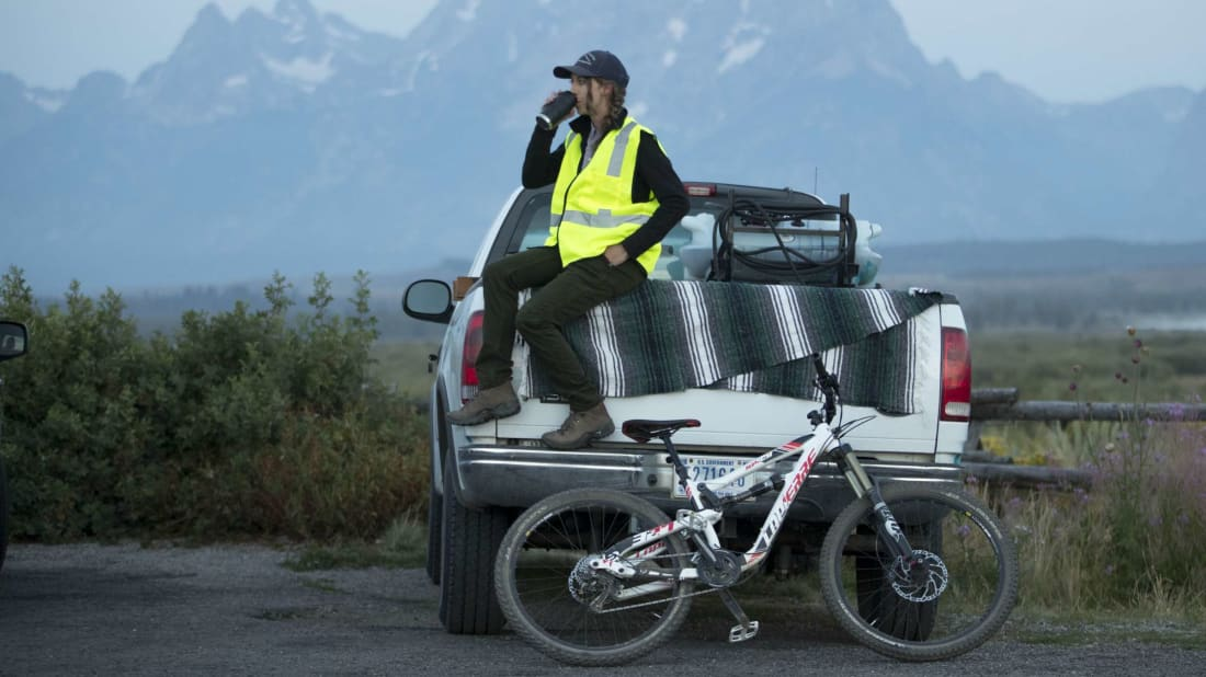 Employee of Grand Teton National Park seated on a truck.