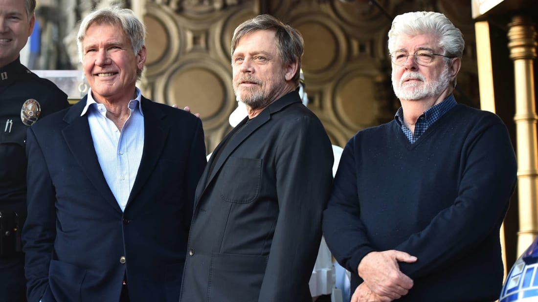 Harrison Ford, Mark Hamill, and George Lucas.
