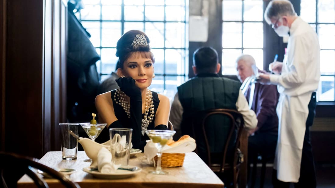 Audrey Hepburn's Holly Golightly looking statuesque in Peter Luger Steak House.