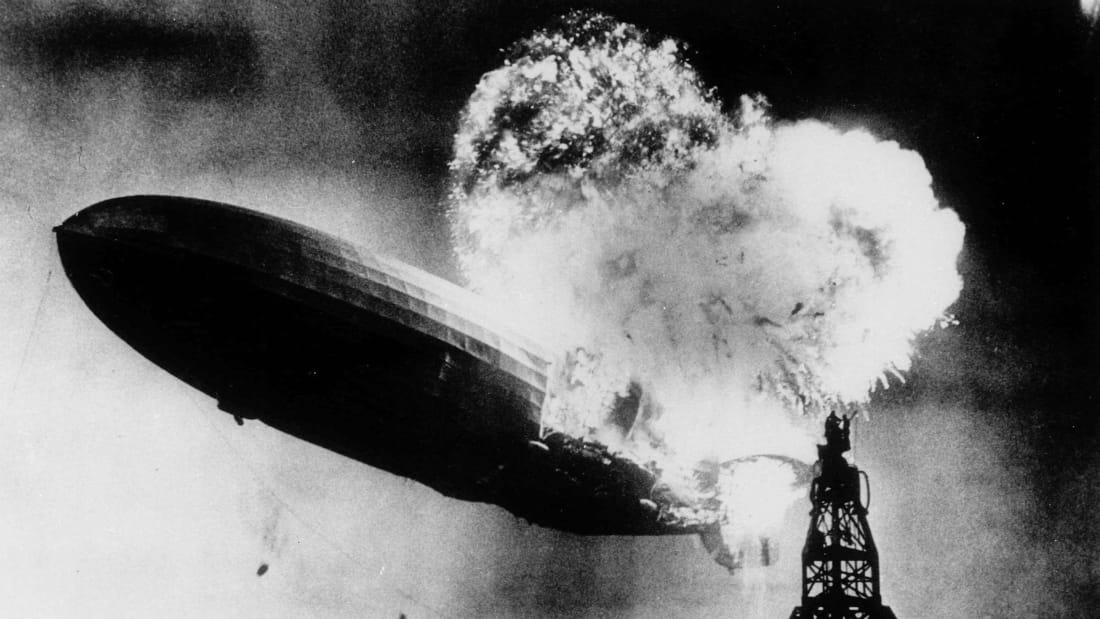 LZ-129 Hindenburg, a rigid airship manufactured in Germany by the Zeppelin Company, catches fire as it comes in for a landing in Lakehurst, New Jersey, on May 6, 1937.