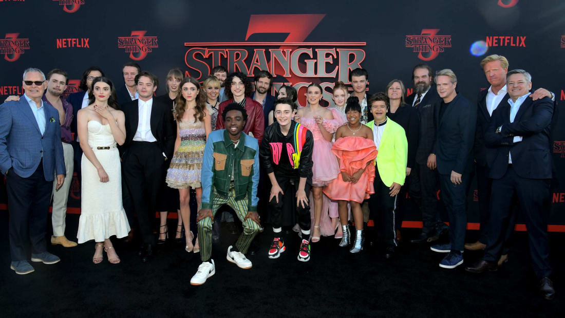 Stranger Things cast and crew pose with Netflix execs at the show's Season 3 world premiere