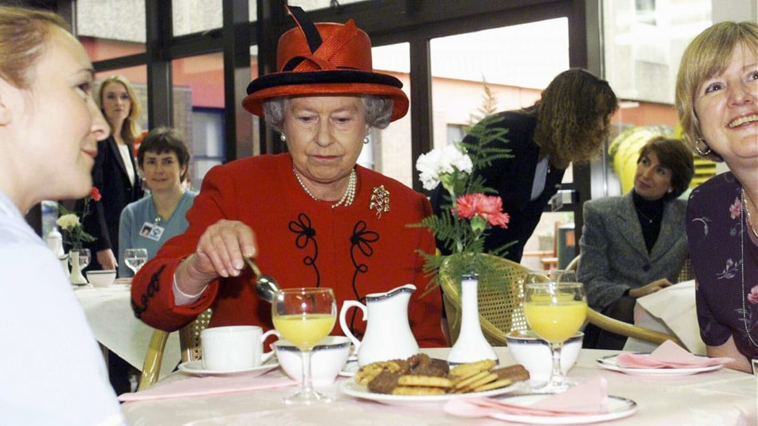Queen Elizabeth II at an afternoon tea event in 1999.