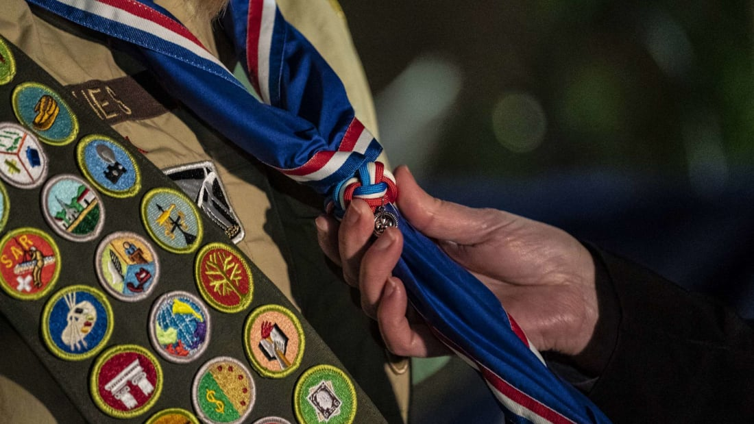 A new scout receiving her Eagle Scout neckerchief at a regional ceremony in Tacoma, Washington.