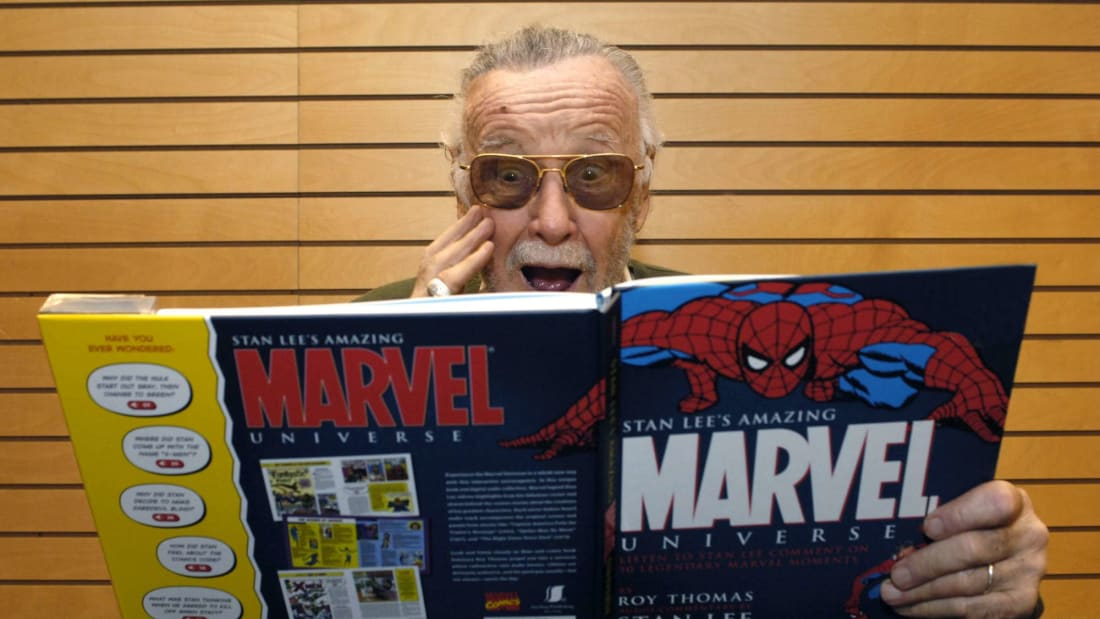 Comic book legend Stan Lee signs copies of his work.