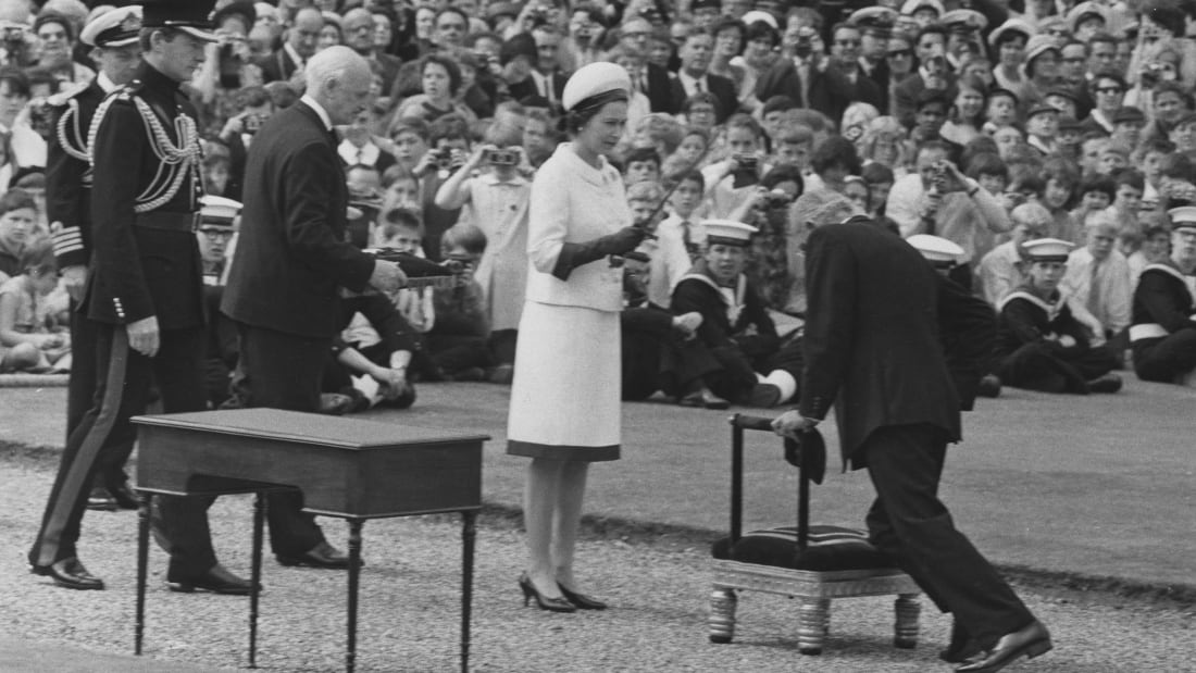 Sir Francis Chichester is knighted by Queen Elizabeth II in 1967.