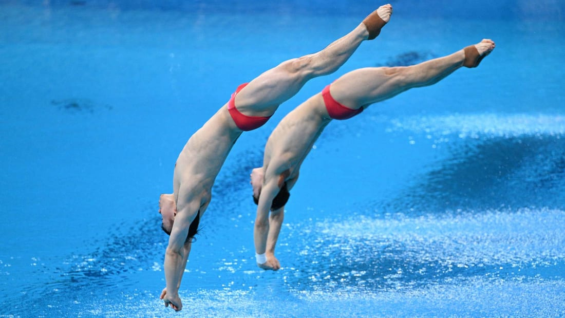 China's Xie Siyi and Wang Zongyuan in the men's synchronized 3-meter springboard diving final at the Tokyo Olympics.