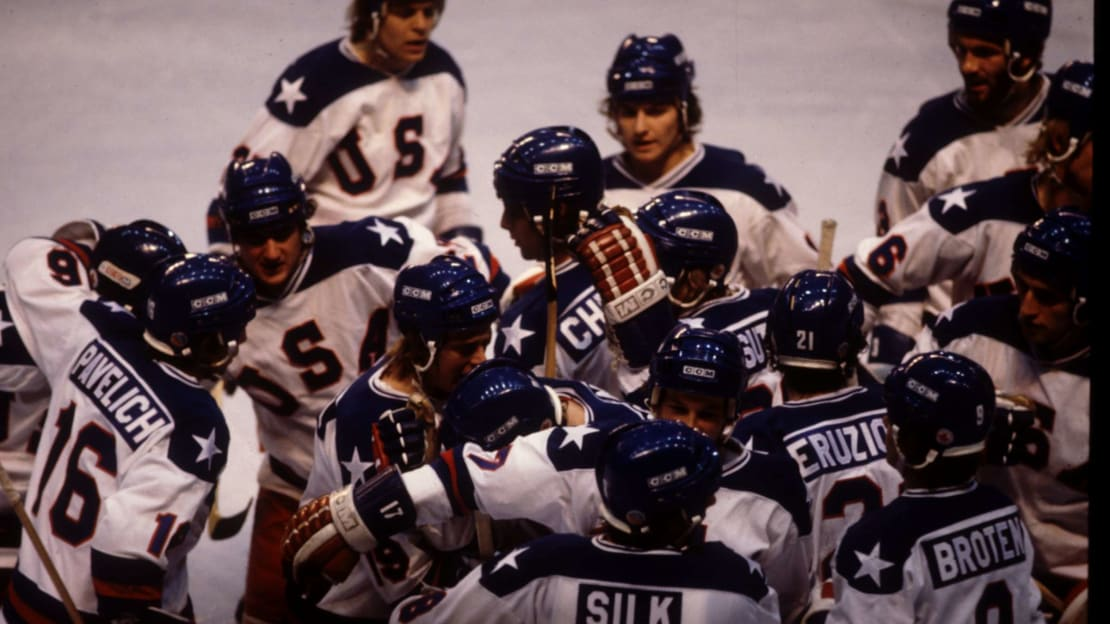 The USA Team celebrates their 4-3 victory over Russia in the semi-final of the Ice Hockey event at the 1980 Winter Olympic Games in Lake Placid, New York.