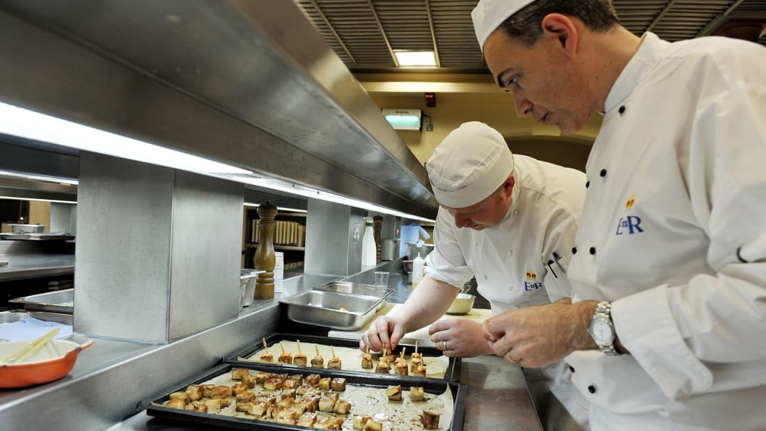 Royal chefs prepare hors d'oeuvres in the Buckingham Palace kitchens.