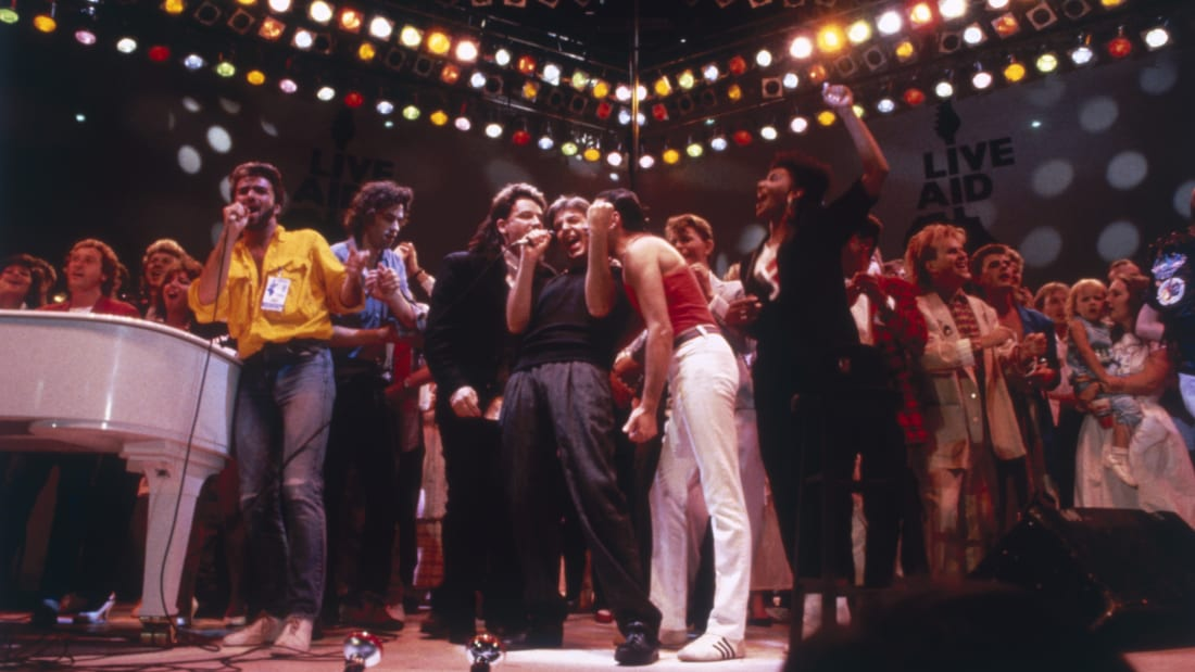 George Michael, Bono, Paul McCartney, Freddie Mercury, David Bowie, Howard Jones, Bob Geldof and other musicians gather on stage for the finale of the Live Aid concert at London's Wembley Stadium on July 13, 1985.